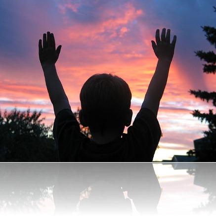 child praising God