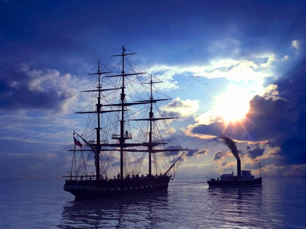 sailboat-and-another-boat-pulling-it-wallpaper