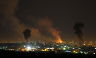 Smoke rises after Israeli air strikes in the northern Gaza Strip